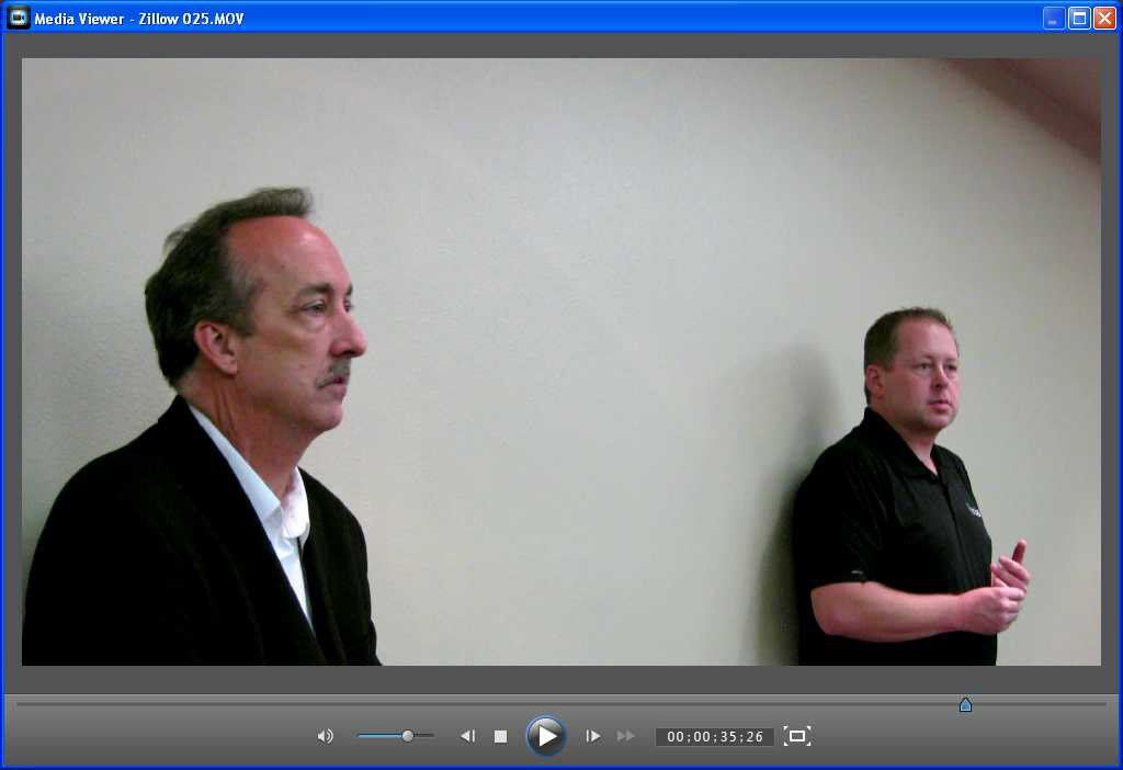 A Zillow representative (foreground) faced a group of disgruntled Denver Realtors in 2013. They objected to having their listing content  used to attract advertising. (Click for the video)