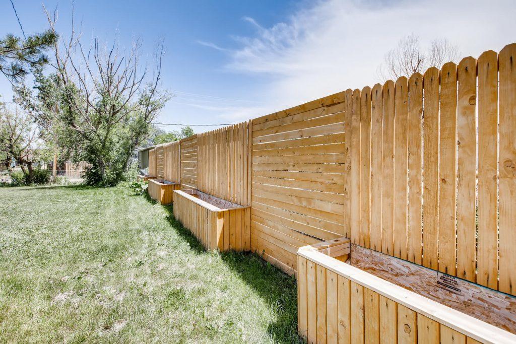 Custom flowerbox fence in the backyard at 1914 Longbranch St. Strasburg Colorado